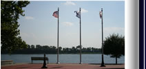 View of flags in front on lake