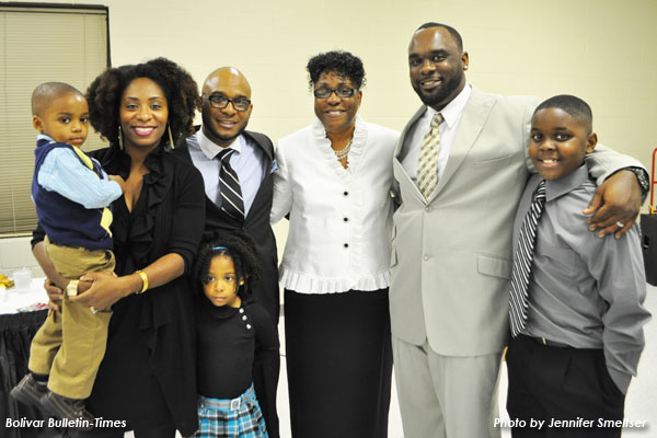 Pictured (l-r) are Mathias Murphy, Dr. Nicie Murphy, Anaiah Murphy, Dexter Murphy, Harvey, Dameon Murphy and Jaylan Murphy.