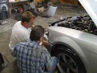 Technicians performing auto repair At Holman's Collision in Auborn, GA