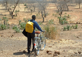 Extending the reach of the Gospel with backpack of Bibles and new bike
