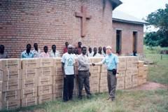 Dr. Hammond delivering Bibles