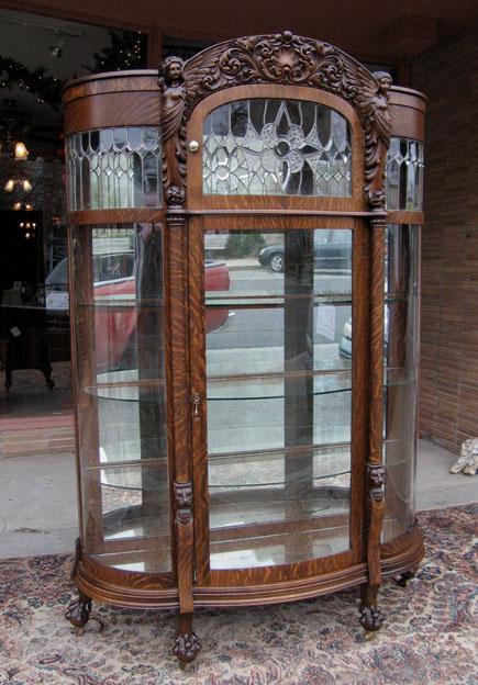 - Quartersawn Oak Winged Angel Curved Glass China Cabinet