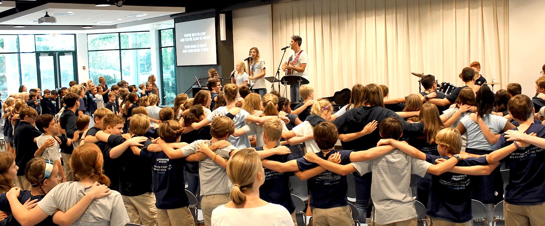 kids dancing at chapel