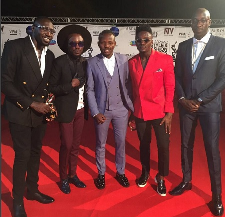 Abrayanz boss strikes a pose with the Sauti Sol folks