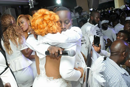 MC Kats hugging Zari during the All White Party
