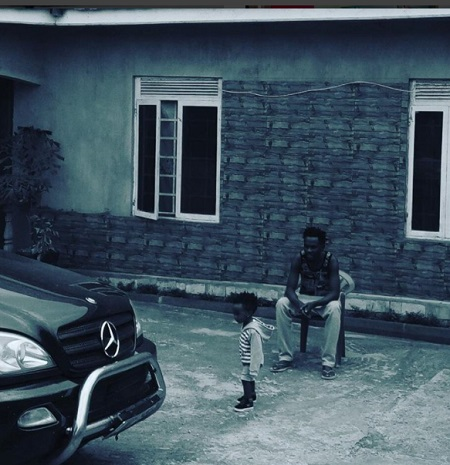 Mun G and his son at his recently completed house