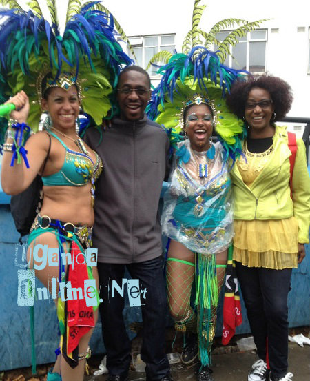 Noting Hill Carnival models posing with some of the Ugandans that attended