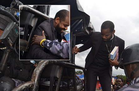 Pastor Ngabo being led to a police truck after the arrest
