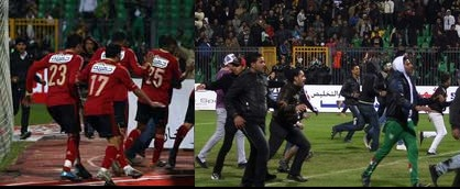 Al-Masri players being evacuated as supporters of Al-Ahly take over the pitch