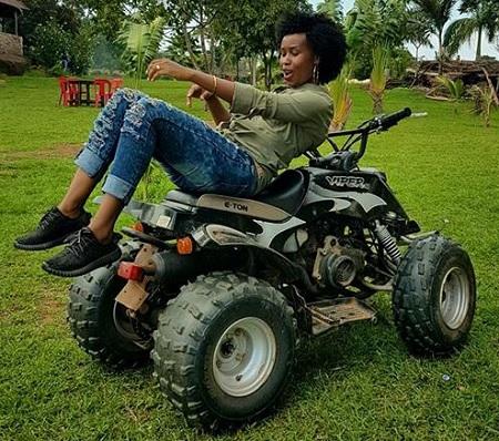 Bobi Wine's wife enjoying the quad bike at One Love Beach