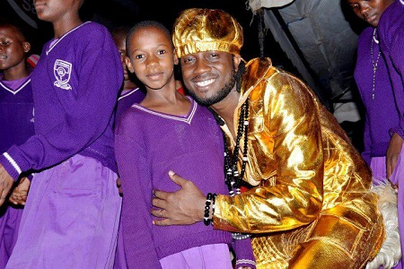 Bebe Cool posing with the kids from Kamuli