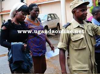 Bad Black being led to a waiting vehicle to Luzira on Oct 20, 2011