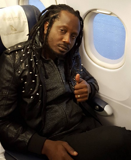 Bebe Cool aboard a South African Airways flight
