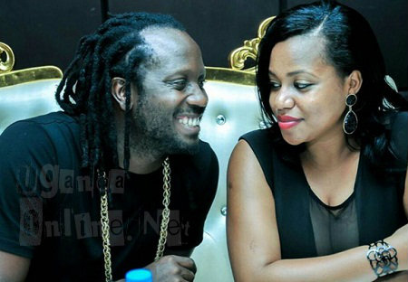 Bebe Cool wears a big smile while looking in Zuena's eyes