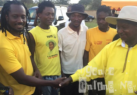 President Museveni shaking Bebe Cool's hand at one of the upcountry rallies