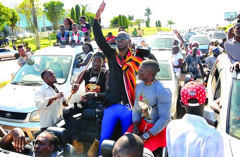 Eddy Kenzo and his fans on Entebbe -Kla highway