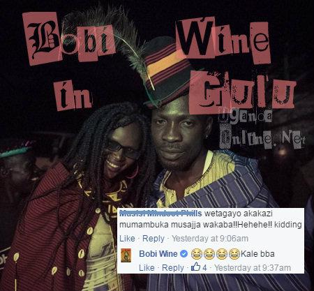 Bobi Wine with a female fan in Gulu
