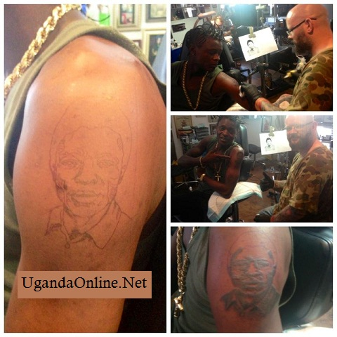 Chameleone showing off his Dad tattoo