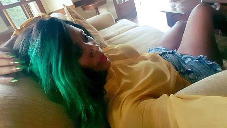 Desire Showing off her green nails and hair