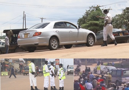 A traffic cop exchanging with a motorist along Entebbe Kampala highway