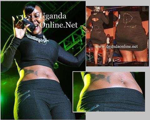 Desire Luzinda showing off her tummy