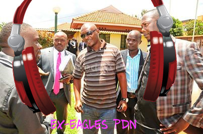 Geoffrey Lutaaya chats with the other ex band members as their lawayer looks on