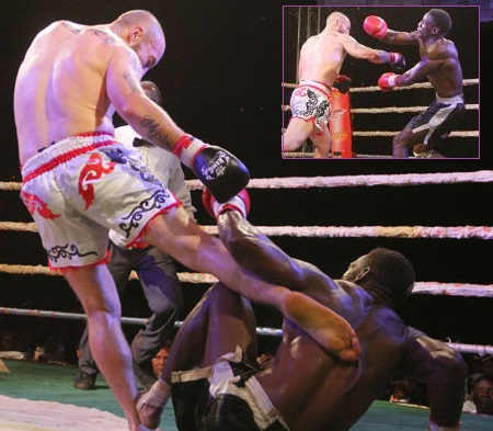 Richard Abraham kicks Golola who was trying to get up from the canvas