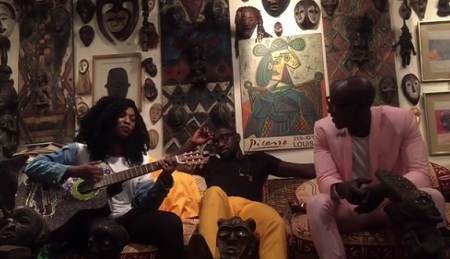 Irene plays with her guitar as the Sauti Sol guys look on