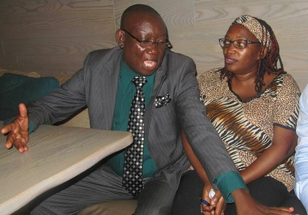 Hon. Kato Lubwama chatting with Dr. Stella Nyanzi