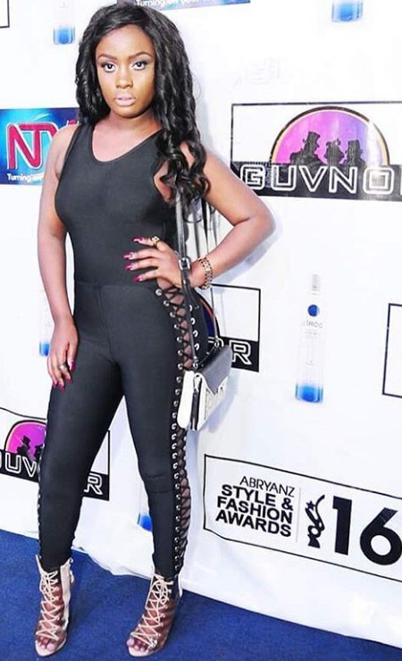 Leila Kayondo in a panty-less jumpsuit