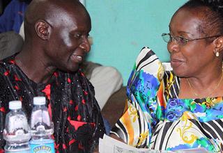 Olara Otunnu chatting with Maama Miria Obote the outgoing UPC Head.