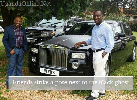 MTN's Aggrey Kagonyera (L) standing next to the posh ride