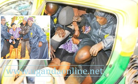 Sarah Kizito being arrested by the KCCA enforcement officers