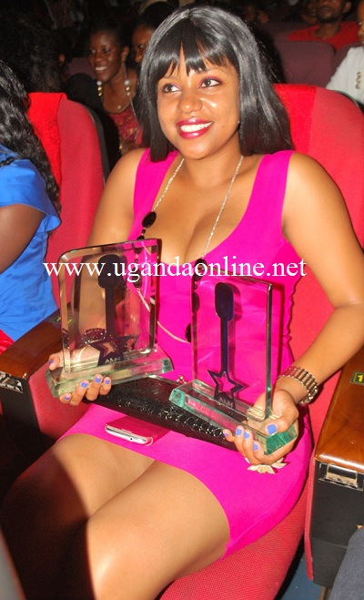 Zuena showing off Bebe Cool's awards