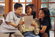 Parent and Children Discussing Schoolwork