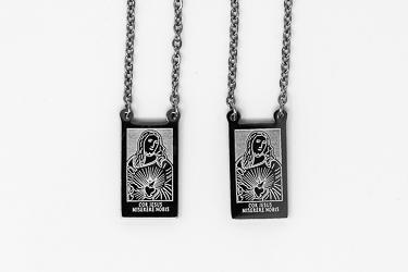 Silver Scapular Necklace.