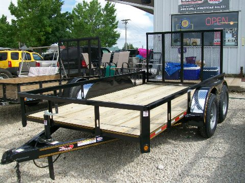 New 20120 Heartland 12 ft Tandem Axle with fold-up gate