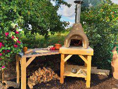 Small onion Bushman Wood fired oven on Rustic wooden stand